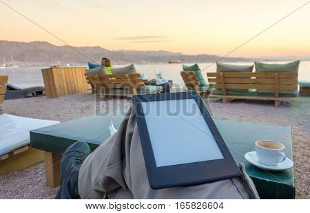 Enjoying An E-book E-reader On The Beach