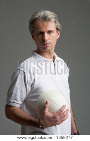 Portrait Of Sporty Man And The Ball