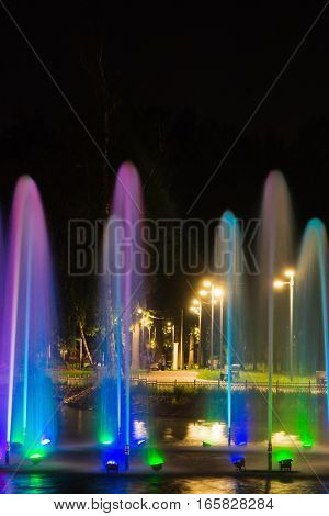 Fountain With Backlight On Pond In The Park