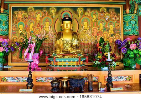 January 12, 2017 in Tehachapi, CA:  Buddha statue surrounded by colorful spiritual objects and decorations on an altar inside the Tae Go Sah Zen Buddhist Monastery where visitors can meditate daily and attend Sunday services taken in Tehachapi, CA