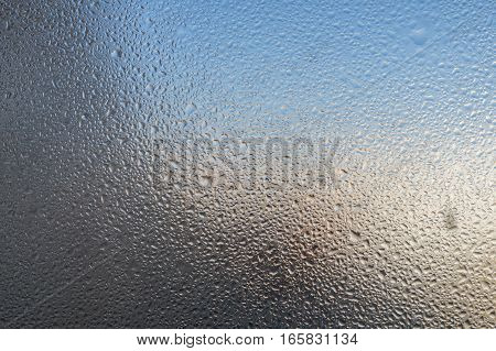 Closeup detail of Moisture condensation problems, hot water vapor condensed on the cold window glass, macro
