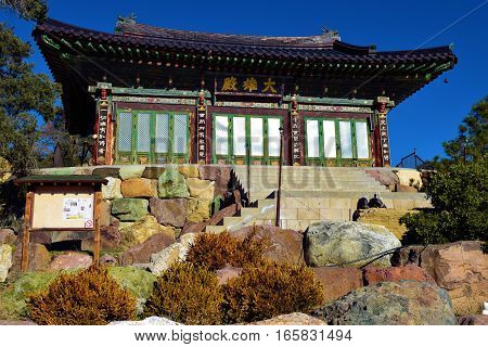 January 12, 2017 in Tehachapi, CA:  Temple structure surrounded by a rural Pine Forest at Tae Go Sah Zen Buddhist Monastery which is a Korean Buddhist Temple where visitors can meditate daily and attend Sunday Services taken in Tehachapi, CA