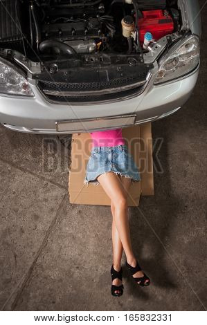 Sexy Girl Lying Under Car Checking The Engine