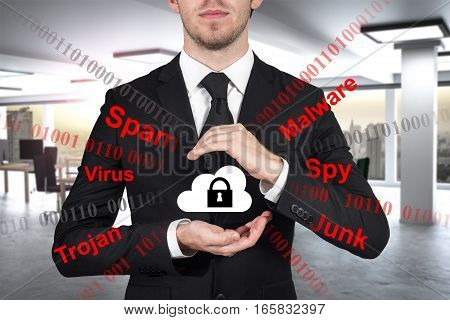 businessman in modern it office protecting cloud data with hands hacker