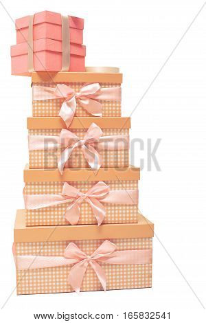 stack of orange gift boxes with satin ribbons on  white background.