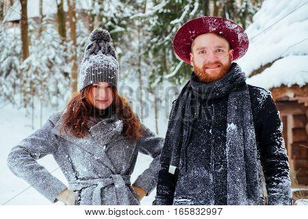 Winter weekend, couple in love having fun on snow in snowfall weather