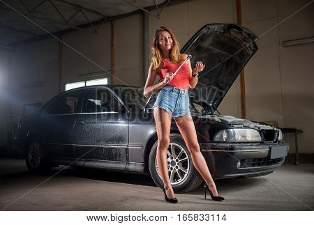 Sexy Lady Standing Near Car At Auto Repair Shop