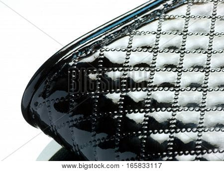 piece black leather bag with relief closeup