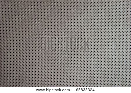 White beige perforated leather texture background skin dots
