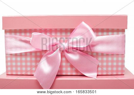 pink gift boxes with satin ribbons on  white background.