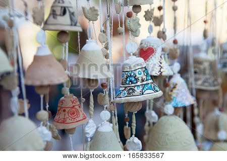 Clay bells Souvenir gift at the market Sorochyntsi, Ukraine