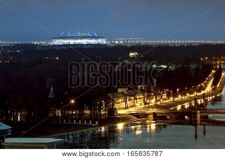 Saint-Petersburg .Russia.December 31 2016.The view from the heights on the river Neva and the Zenit arena in the evening lights in St. Petersburg.
