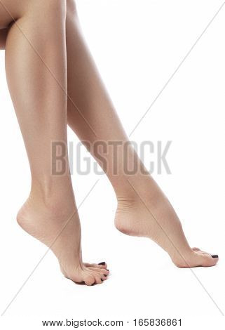 Beautiful female legs after depilation. Healthcare foot care rutine treatment. Spa and epilation. Sexy shape of woman's body. Part of female body. Feet with perfect clean smooth skin and pedicure.