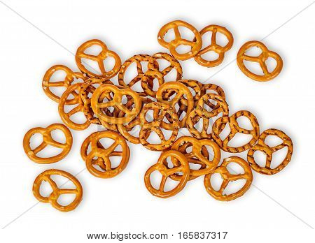 Heap crunchy pretzels with salt isolated on white background