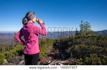 Portrait Of Young Woman Hiker With Cup Of Tea