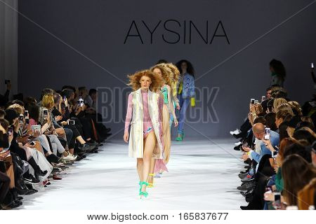 KYIV, UKRAINE - OCTOBER 13, 2016: Models walk the runway at Yulia Aysina collection show during the 39th Ukrainian Fashion Week at Mystetsky Arsenal in Kyiv