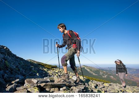 Young Backpacker Couple Walking Up Rocky The Mountain Top