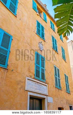 AJACCIO FRANCE - MAY 2 2013: The Maison Bonaparte is the Napoleon's birth house with the small stone sign board above the entrance located in St Charles street on May 2 in Ajaccio.