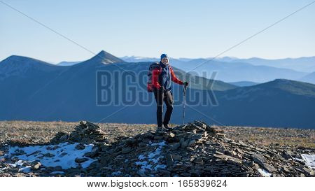 Old Athletic Woman Backpacker On The Top Of The Mountain