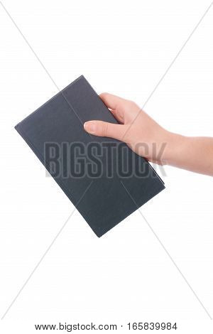 Close up of hand holding a book isolated