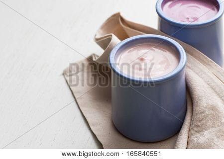 Yoghurts Assortment  In Ceramic Bowls On Wooden Ligth Background. Natural And Fruit  Healthy, Diet,
