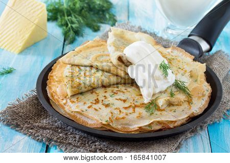 Not Sweet Pancakes With Cheese And Fresh Dill In A Cast Iron Skillet, Served With Sour Cream. Breakf