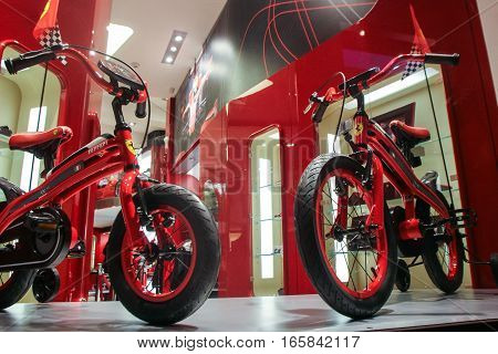 Bucharest Romania December 5 2009: Two Ferrari bicycles are seen in the window at the opening of the Ferrari showroom in Bucharest.