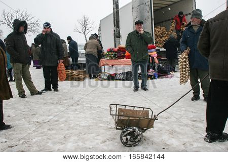 Calugareni Romania December 20 2009: Vendors are selling different products in the animal market in Calugareni. Before Christmas animal breeders are selling and sacrificing their animals in animal markets and vendors are selling different products.