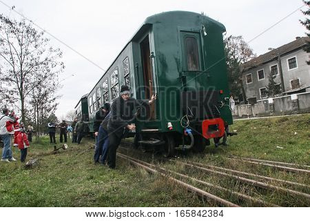 Brad Romania December12 2009: Mechanics are pushing an old steamed cog train in Brad on winter holydays.