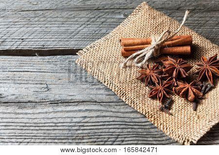Fragrant Spices, Cinnamon, Cloves And Anise On Sackcloth