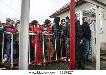 Cretesti Ilfov County Romania December 6 2009: People standing in a queue to vote in Cretesti Ilfov County.