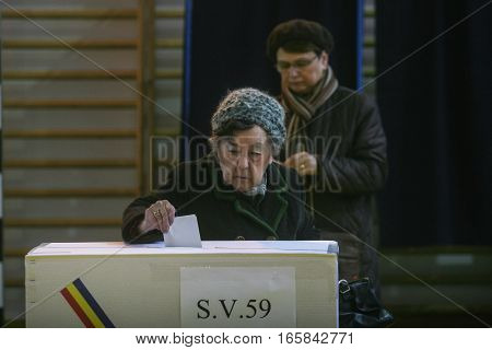 Bucharest Romania December 6 2009: An old woman is voting for presidential elections in Bucharest.