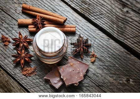 Chocolate Skin Treatment. Cosmetic Jar With Lotion, Cocoa, Anise, Cinnamon Sticks.