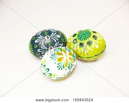 Three ornate easter eggs decorated by bee wax isolated