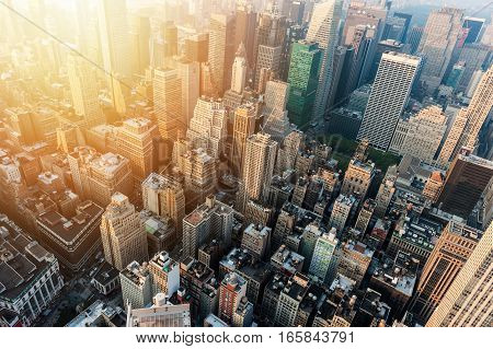 New York City skyline with urban skyscrapers at sunset.
