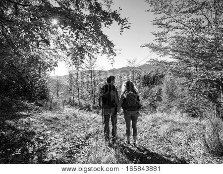 Couple Hikers Enjoying Beautiful Scenery On Valley
