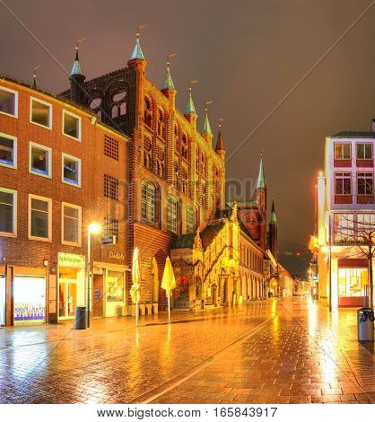 LUBECK GERMANY - January 15 2017: The town hall with the Renaissance staircase on pedestrian street in Lubeck Germany