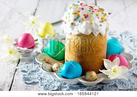 The Traditional Easter Treats: Cakes And Colorful Easter Eggs On A Wooden Table. Copy Space.