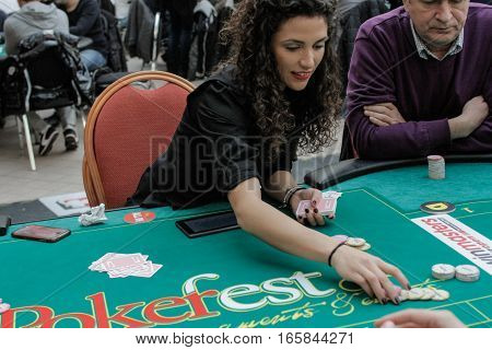 Bucharest Romania December 19 2015: A croupier arranges chips in a poker festival organized in Bucharest.