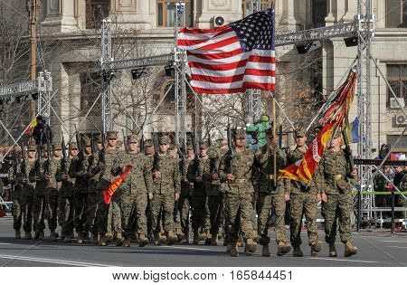 BUCHAREST ROMANIA DECEMBER 1 2015: American military are marching for the National Day of Romania military parade in Bucharest. More than 3000 soldiers and personnel from security agencies take part in the massive parades on National Day of Romania.