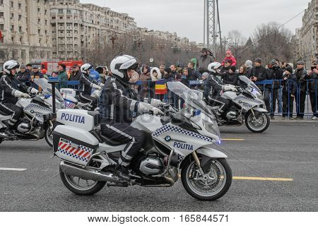 BUCHAREST ROMANIA - November 29 2015: Policemen are marching during a rehearsal for National Day of Romania military parade in Bucharest. More than 3000 soldiers and personnel from security agencies take part in the massive parades on National Day of Roma