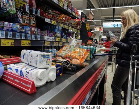 Bucharest Romania December 24 2015: Customers paying for shopping at a supermarket. Line at the cashdesks in the supermarket.