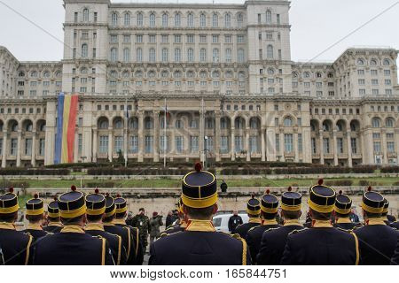 BUCHAREST ROMANIA - November 29 2015: Military are marching during a rehearsal for National Day of Romania military parade in Bucharest in front of the Romanian Parliament. More than 3000 soldiers and personnel from security agencies take part in the mass