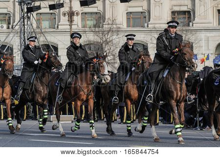 BUCHAREST ROMANIA DECEMBER 1 2015: Police on horses are marching for the National Day of Romania military parade in Bucharest. More than 3000 soldiers and personnel from security agencies take part in the massive parades on National Day of Romania.
