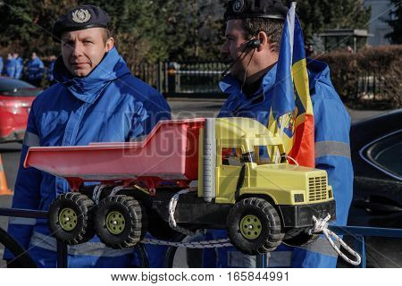 Bucharest Romania December 17 2015: Two policemen participate at a protest of private transporters organized in front of the Romanian Government building in Bucharest.