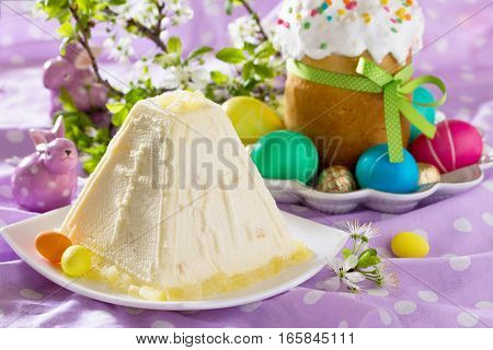 Easter Background. The Traditional Easter Treats: Cakes And Colorful Easter Eggs. Copy Space.