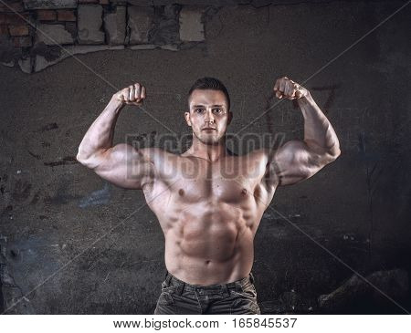 Bodybuilder On Grunge Wall