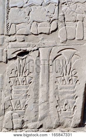 Bas-relief of palm trees on the wall of Karnak Temple in Egypt.