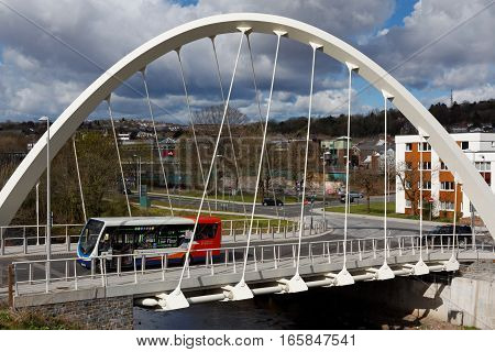 Merthyr Tydfil, Wales, UK - April 26th, 2016: Local Bus Crossing The River Taff Central Link Bridge, Merthyr Tydfil, South Wales