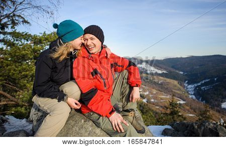 Young Couple Of Hikers On Top Of Mountain